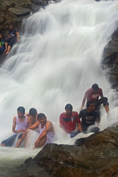 People chilling out under waterfalls